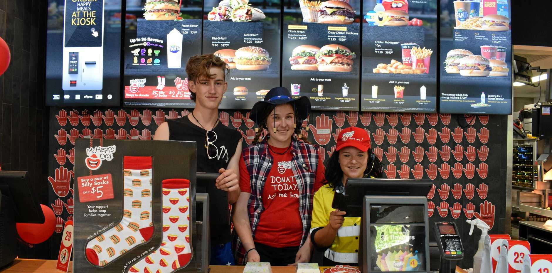 MCHAPPY TIME: McDonald's Boyne Island staff Lachlan Bryars, Olivia Lester and Jayde MacBean worked hard serving customers on McHappy Day.
