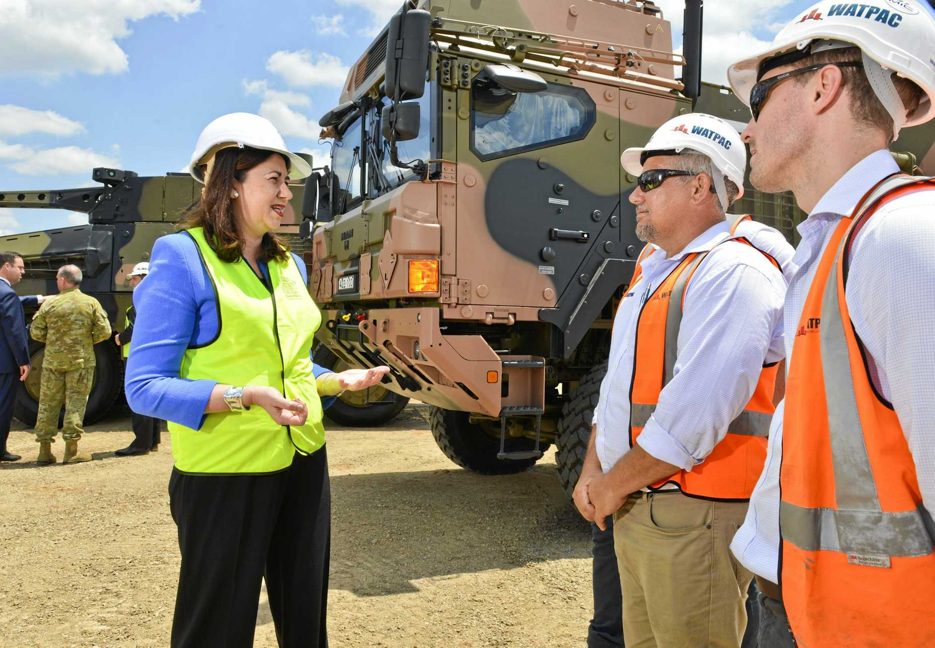 JOBS: Queensland Premier Annastacia Palaszczuk speaks with workers at the launch of the $170 million Rheinmetall Military Vehicle Centre at Redbank.
