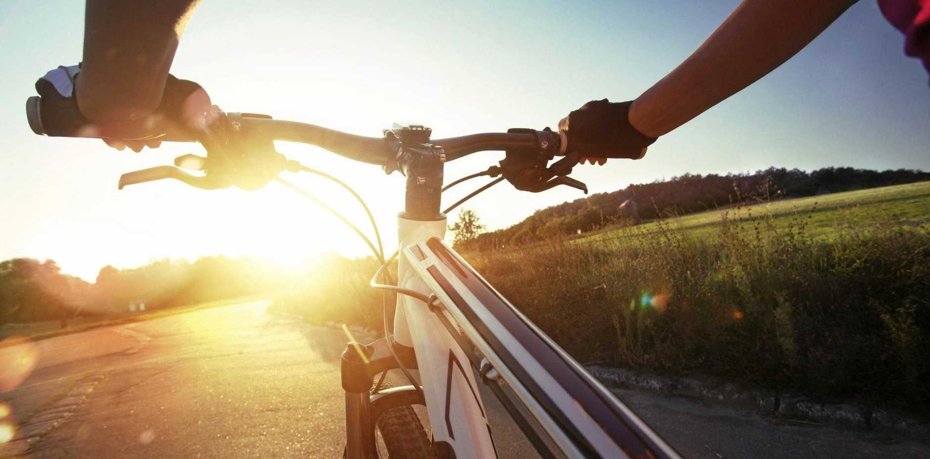 The Queensland Government says the costs involved with charging bike riders a registration fee