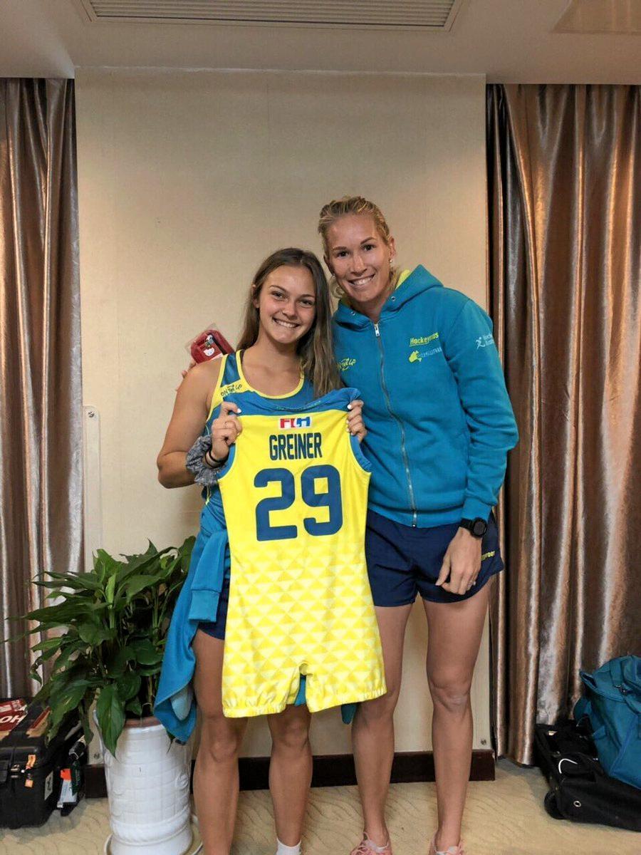 Bundaberg's Rebecca Greiner receives her Hockeyroo jersey from a former player.