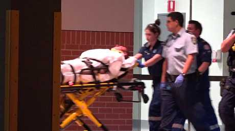 """Nicola """"Nick"""" Gilio, stabbed by the alleged attacker, is taken to a waiting ambulance. Picture: TVN"""