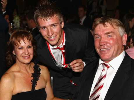 Kieren Jack poses with parents Garry and Donna in happier times in 2010.