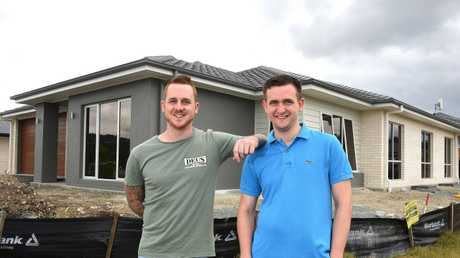 Brothers Martin and Sean Troyahn outside their new home in Bahrs Scrub, near Beenleigh. Picture: John Gass/AAP