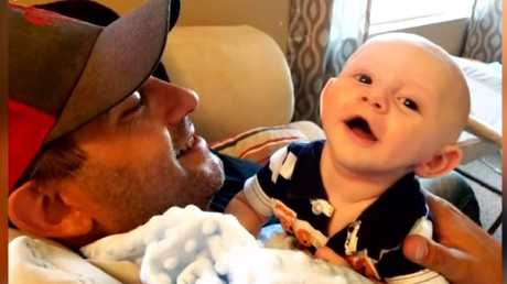 Six-month-old Jaxon Liedl, above with his father Nate, died earlier this month after a young girl allegedly stomped on his head.