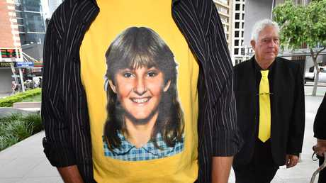 A t-shirt displaying a photograph of the victim Annette Mason, is seen as her father, Mick Mason walks outside the Brisbane Coroners Court. Picture: AAP Image/Darren England