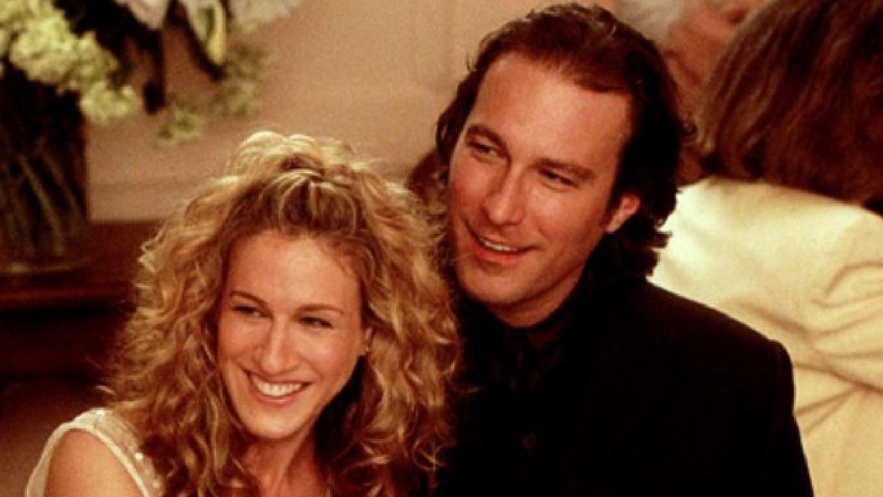 Sarah Jessica Parker (as Carrie) and John Corbett (as Aidan) in a scene from Sex and the City.