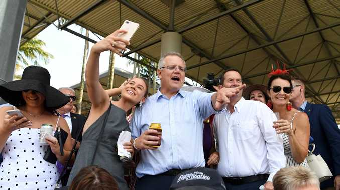Prime Minister Scott Morrison (centre) watches the Melbourne Cup with racegoers at Caloundra's Corbould Park during his Queensland tour. Picture: AAP Image/Dan Peled