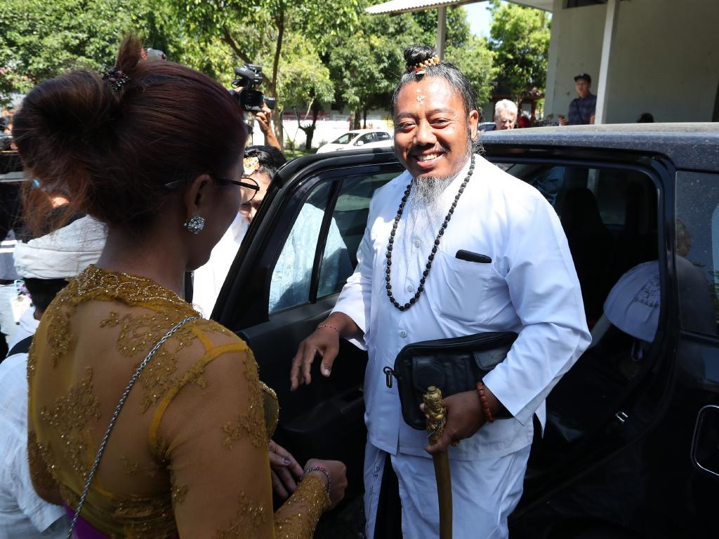 The Balinese  Hindu High Priest arrives to conduct the farewell ceremony. Picture: Liam Kidston.
