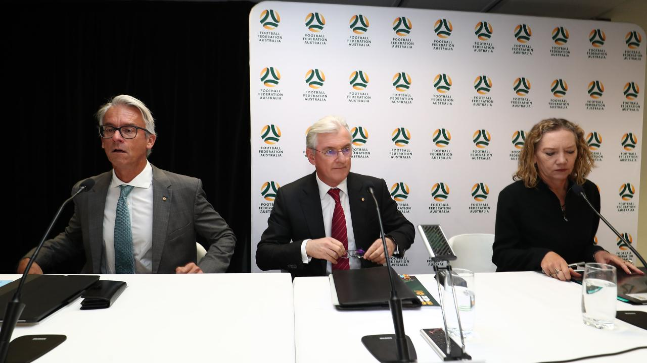 Outgoing FFA chairman Steven Lowy (C) and FFA CEO David Gallop (L). Picture: Getty