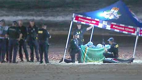 Police at the scene where a baby girl died on the beach at Surfers Paradise. Picture: Channel 7