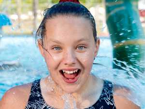 Mia Bradford, 11, cools down at Pioneer Swim
