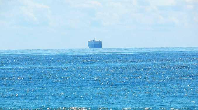 Massive anchored car carrier raises concerns