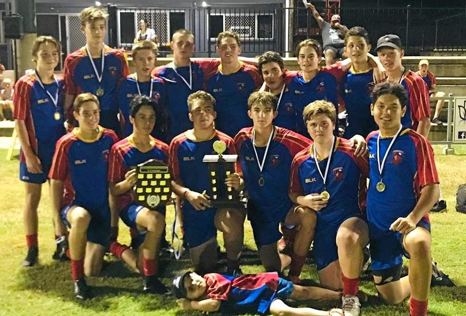 CHAMPION EFFORT: The Nogoa Red Claws under-15 players celebrate after capping another dominant season with a convincing grand final win at Rugby Park on Saturday.