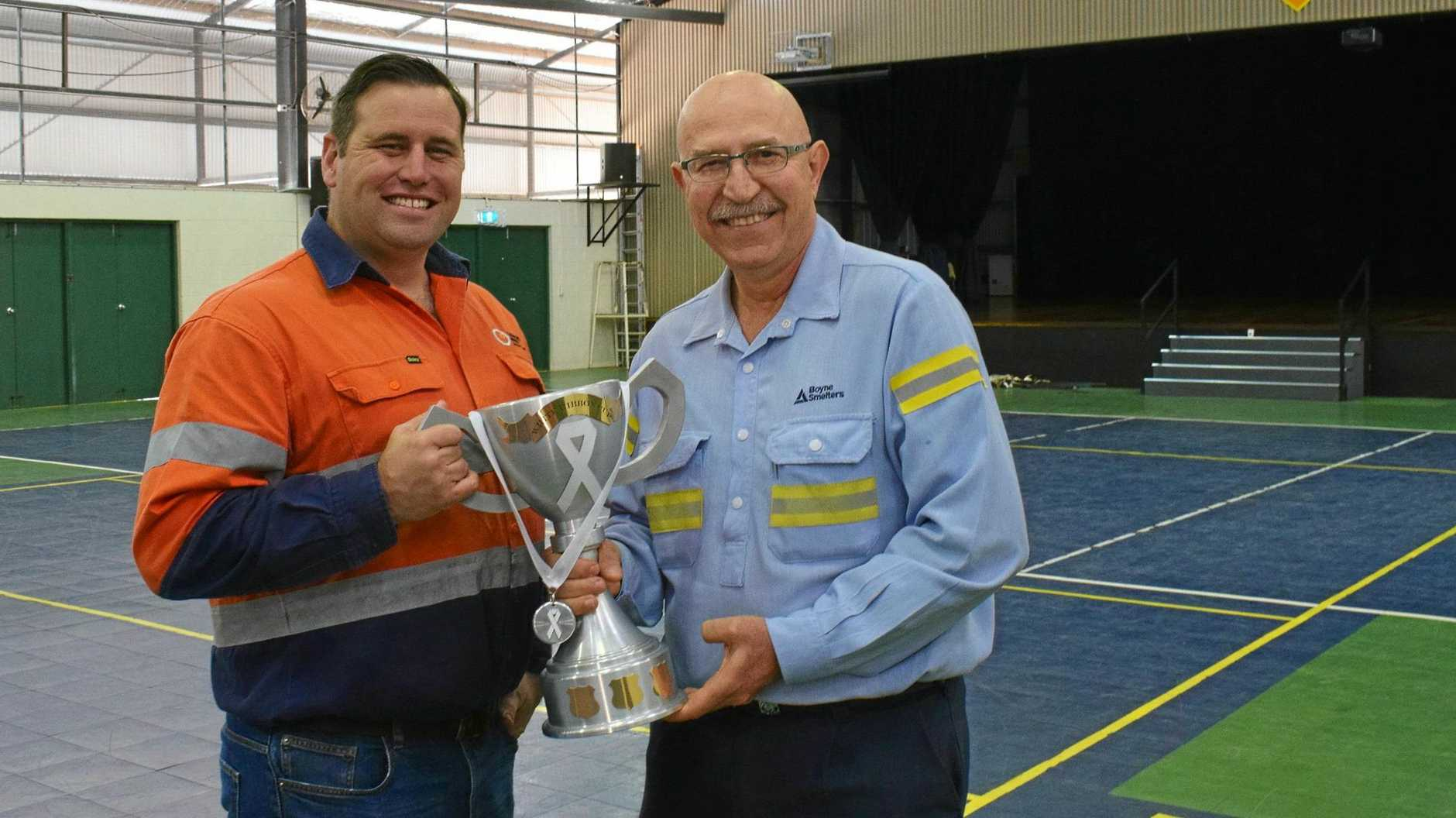 WHITE RIBBON CUP: Gladstone Industry Leadership Group chief executive Patrick Hastings and Boyne Smelter general manager Joe Rea holding the smelter-made Cup trophy.