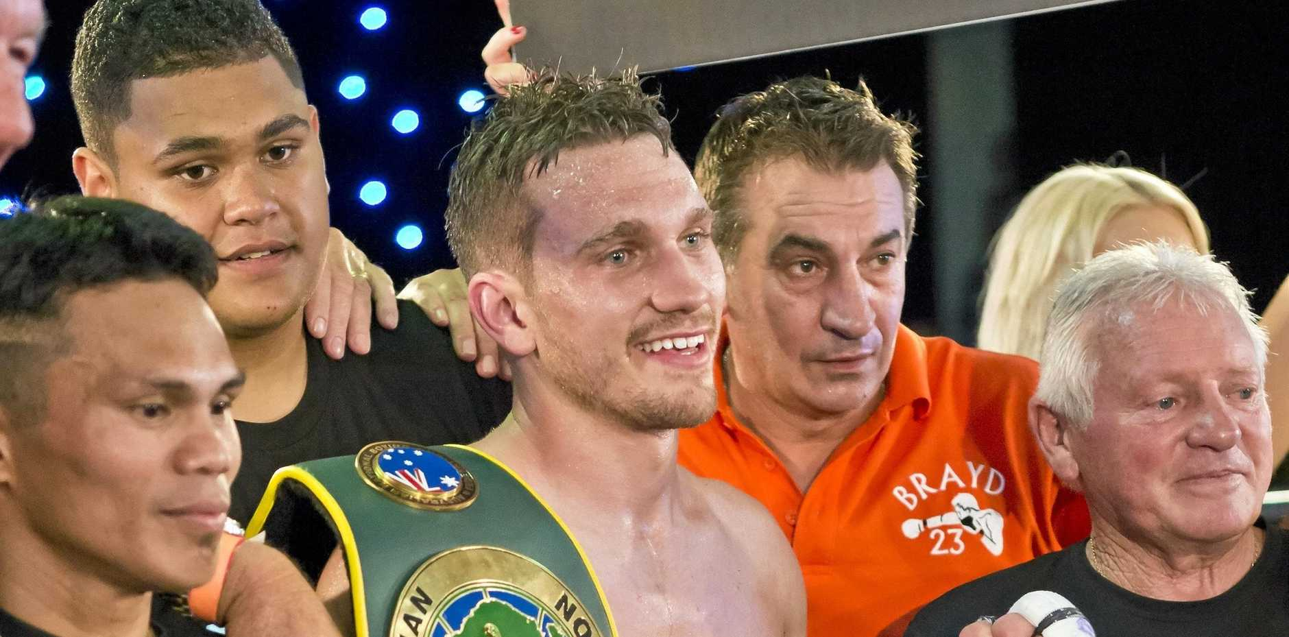 TEAM EFFORT: Steve Spark celebrates with his supporters (from left) Jack Asis, Corban Kanaveilomani, trainer Brendon Smith and Bert Hornery after his win this month over Japan's Taisho Ozawa for the WUC Brayd Smith super lightweight title at Rumours International.