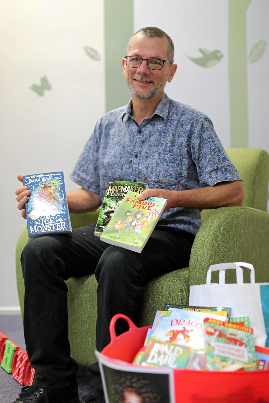 Councillor Dan Stewart encourages people to get on board this year's Christmas Cheer Book Appeal in the wake of a record-setting effort in 2017.