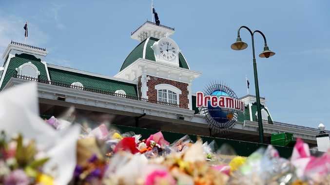 Flowers at a memorial out the front of Dreamworld following the Thunder River Rapids ride tragedy. Picture: Getty