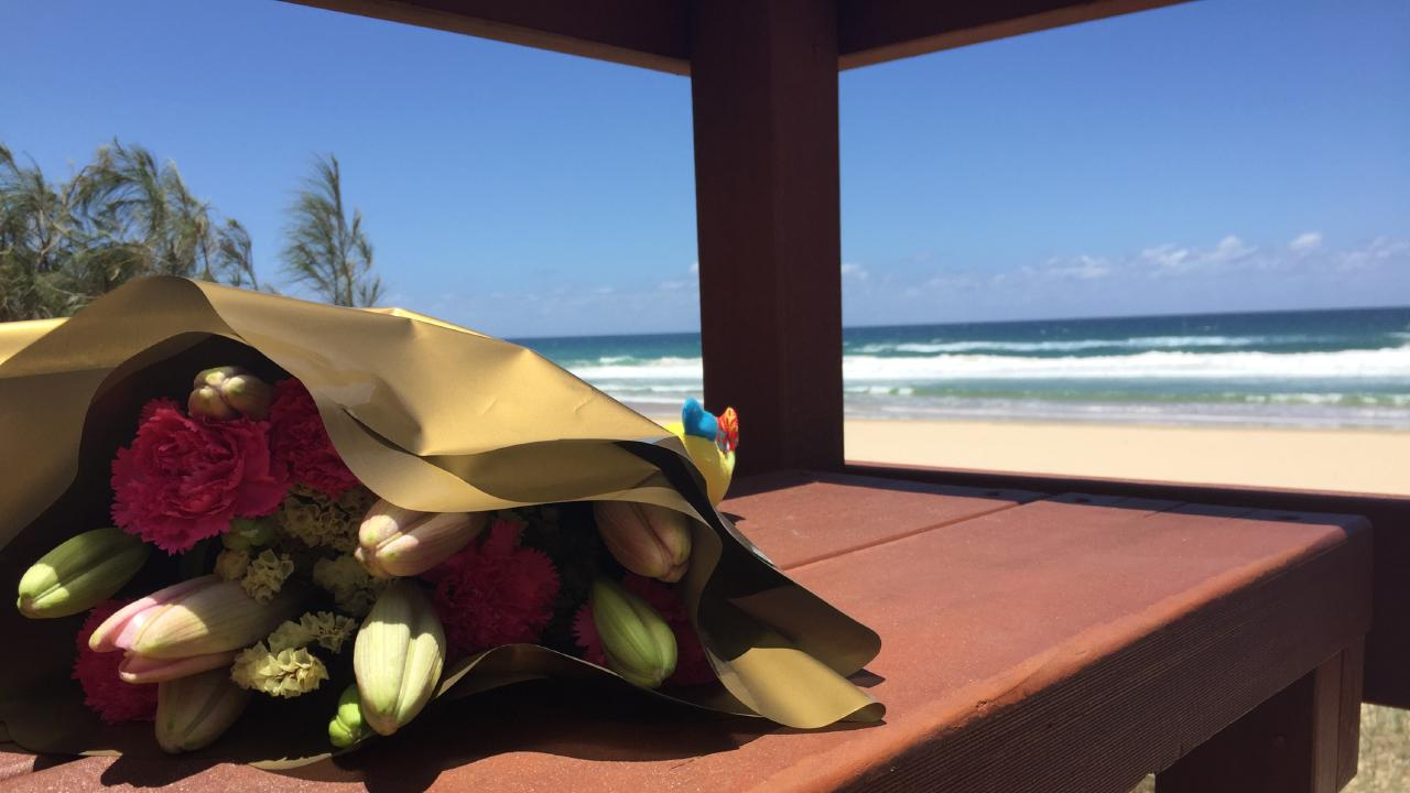 Flowers left in memory of the nine-month-old girl who was found dead on Surfers Paradise beach. Picture: Talisa Eley