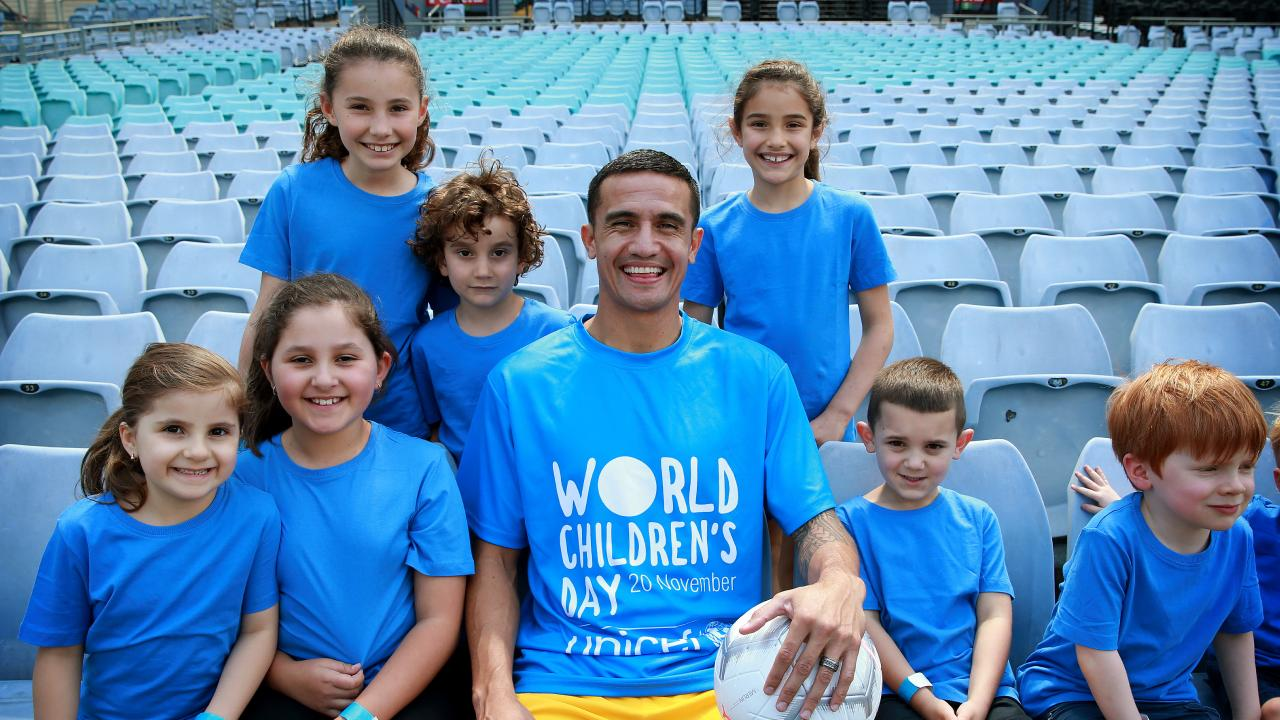 Socceroos star and UNICEF ambassador Tim Cahill pictured at ANZ Stadium where he will represent Australia for the last time in a friendly against Lebanon with kids (front L-R) Mirela Naso 5, Siena Naso 8, Jacob Thomas 5 and William Lawson 4 and (back L-R) Charlotte Nichols 9, Jim Nichols 4 and Juliette Nichols 7. Picture: Toby Zerna