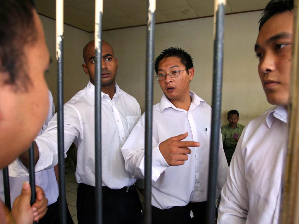 Lawrence said Myuran Sukumaran and Andrew Chan (above before trial with Tan Duc Tanh Nguyen) threatened her family. Picture: Lukman S Bintoro.