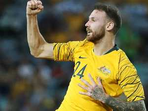 Socceroos unearth new hero as Cahill says goodbye