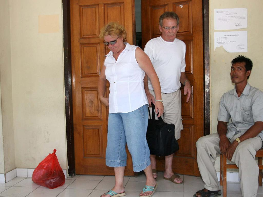 Renae Lawrence's father Bob and his wife Jenny leave Kerobokan jail after visiting her.