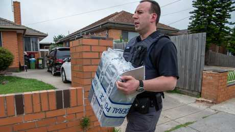 Police remove items from the Campbellfield home. Picture: Jason Edwards