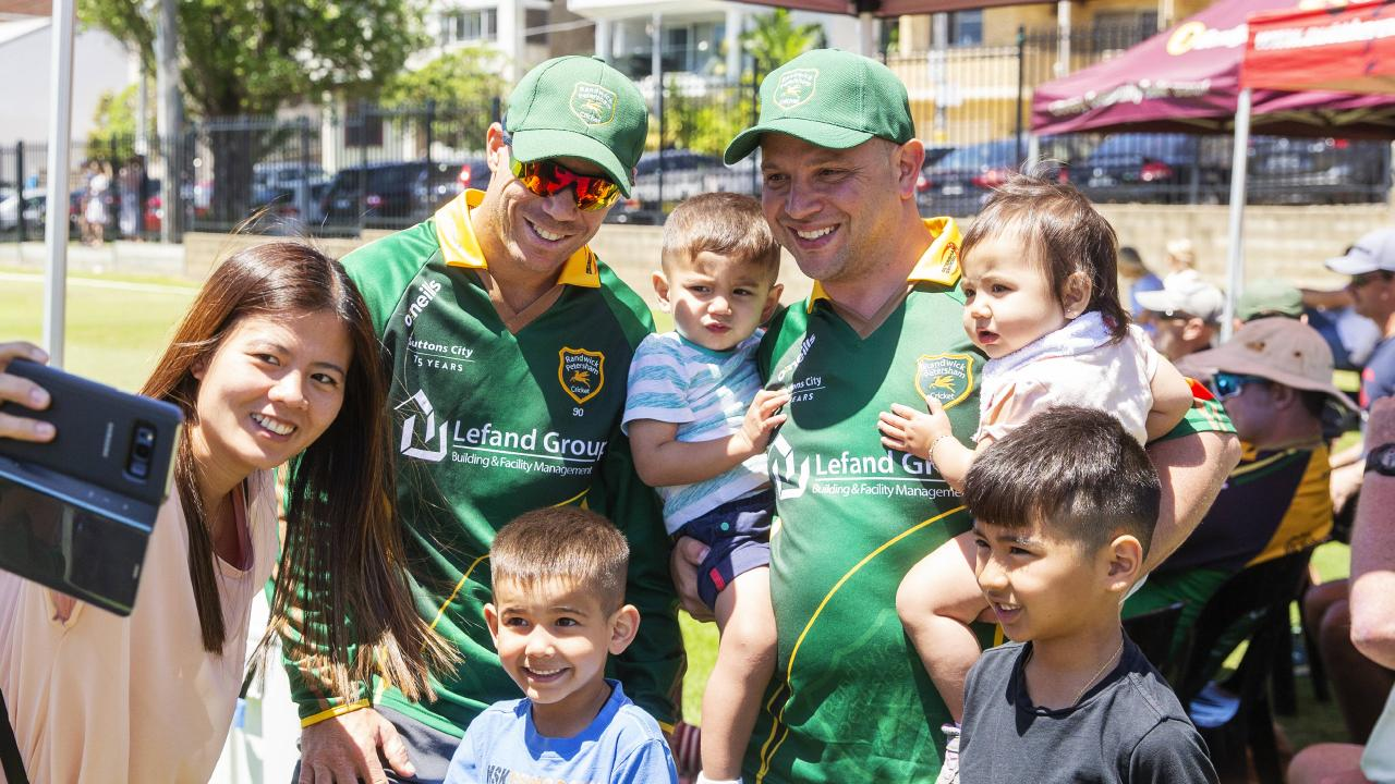 Dave Warner poses with fans at Coogee Oval during a first-grade match. Picture: Jenny Evans