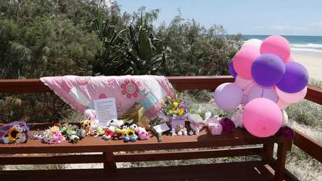 Tributes to the baby that was found dead on the beach in Surfers Paradise near Staghorn Ave. Photo: Tertius Pickard