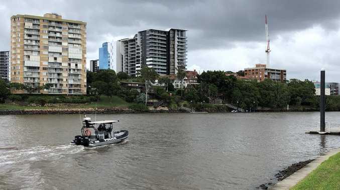 Police patrol Brisbane River after a