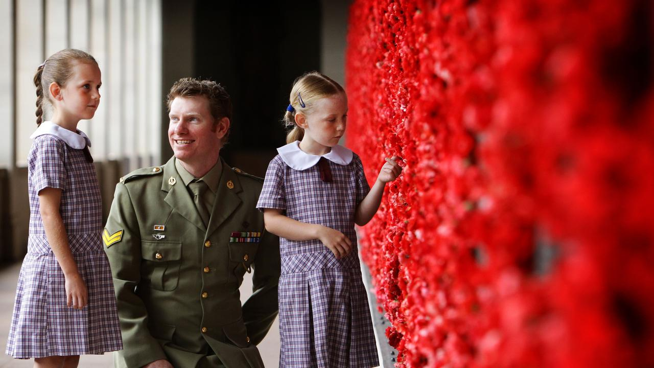 Keighran, who is a member of the Council of the Australian War Memorial, with 8-year-old Isobelle Toohey and 6-year-old Hannah Toohey at the Canberra building.
