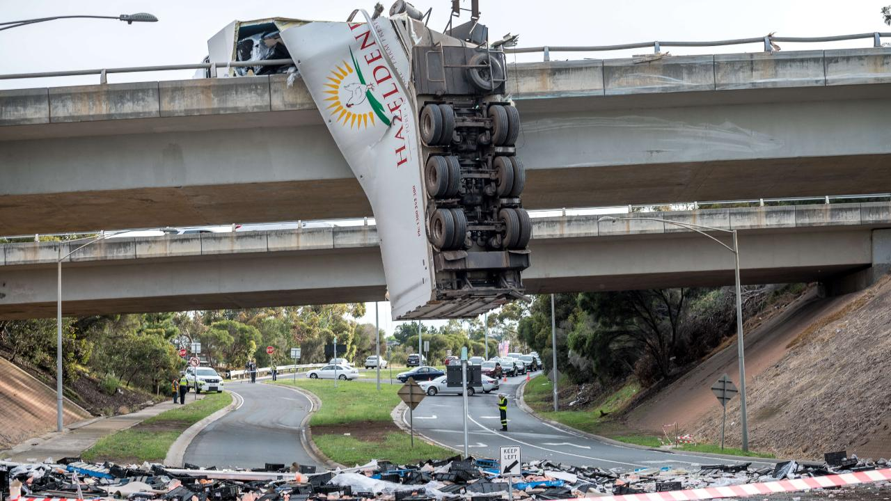 A Hazeldene's Chicken Farm truck hangs off the Calder Freeway in Keilor. Picture: Jake Nowakowski