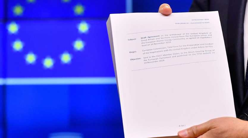 European Council President Donald Tusk holds the
