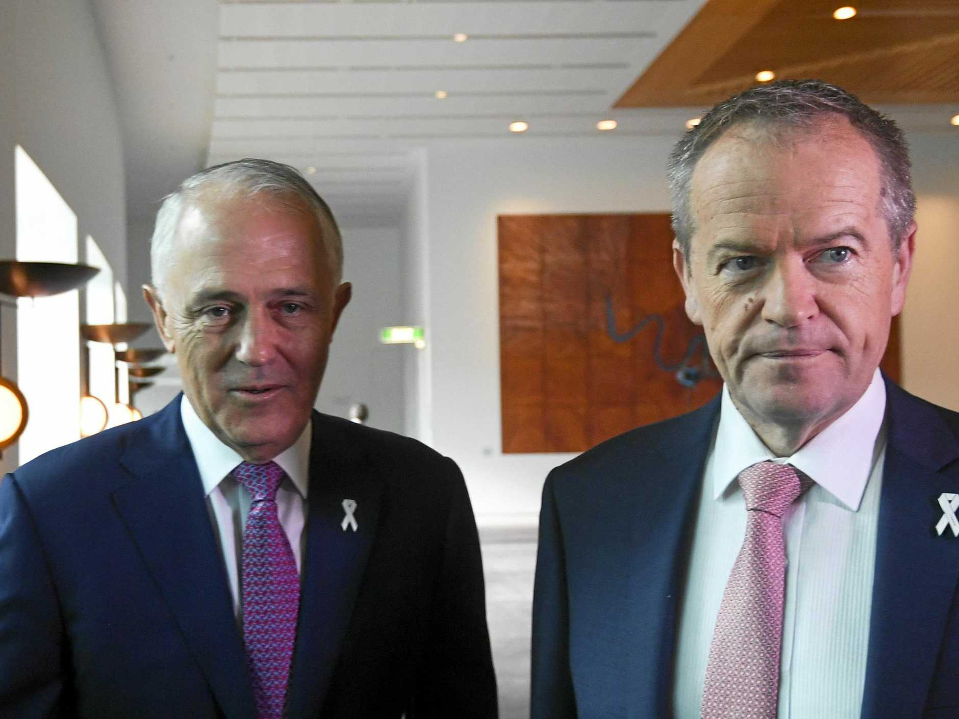 TOKENISM: Australian Opposition Leader Bill Shorten (right) and then Australian Prime Minister Malcolm Turnbull arrive at a White Ribbon Day Parliamentary Breakfast at Parliament House in Canberra last year. There will be white ribbons all over politicians this week but to what avail?