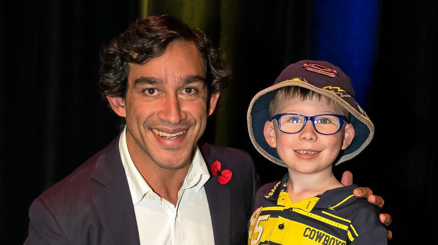 HEROIC HUG: Six-year-old Mason Fischer from Warwick got to meet his idol Jonathan Thurston as the winner of a Warwick Daily News reader prize.