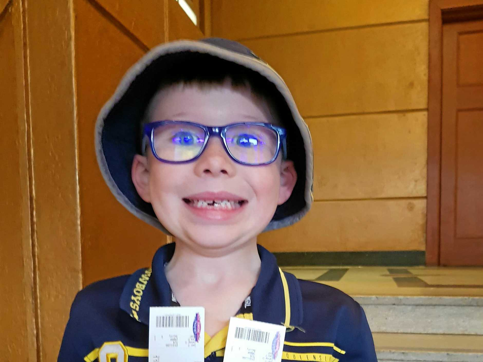 An excited Mason Fischer with two diamond tickets to see Jonanthan Thurston.