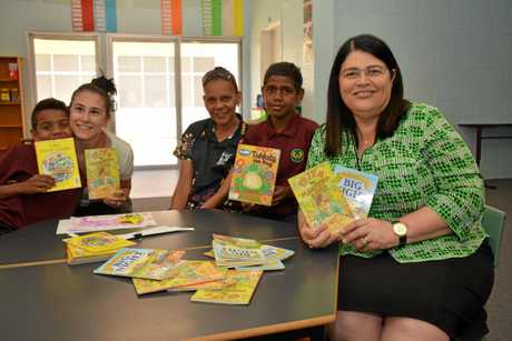 READING: Cherbourg State School Year 4 students Thomas Langton and Victor Collins reads with Luana Savinelli, Bella Joe and Education Minister Grace Grace on November 20.