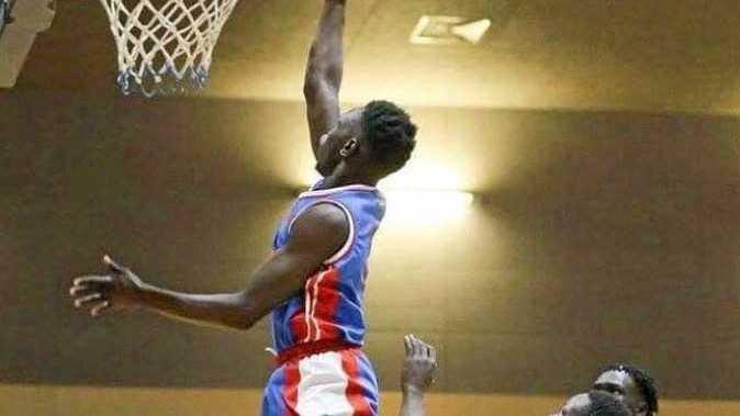 DUNKING POWER: Nathaniel 'Nash' Koko shows his atleticism.
