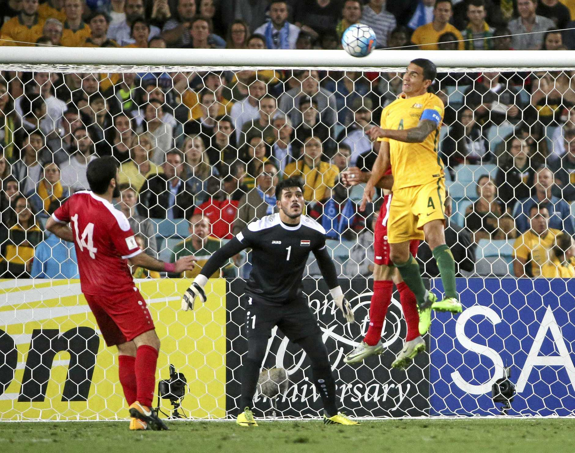 TRADEMARK: Australia's Tim Cahill, right, scores another towering header against Syria during their World Cup qualifying match in Sydney, Australia, Tuesday, Oct. 10, 2017.