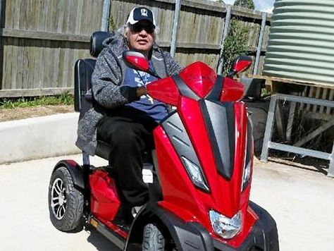 ON THE MOVE: Ashley Malone on his new scooter provided by the Men of League Foundation.