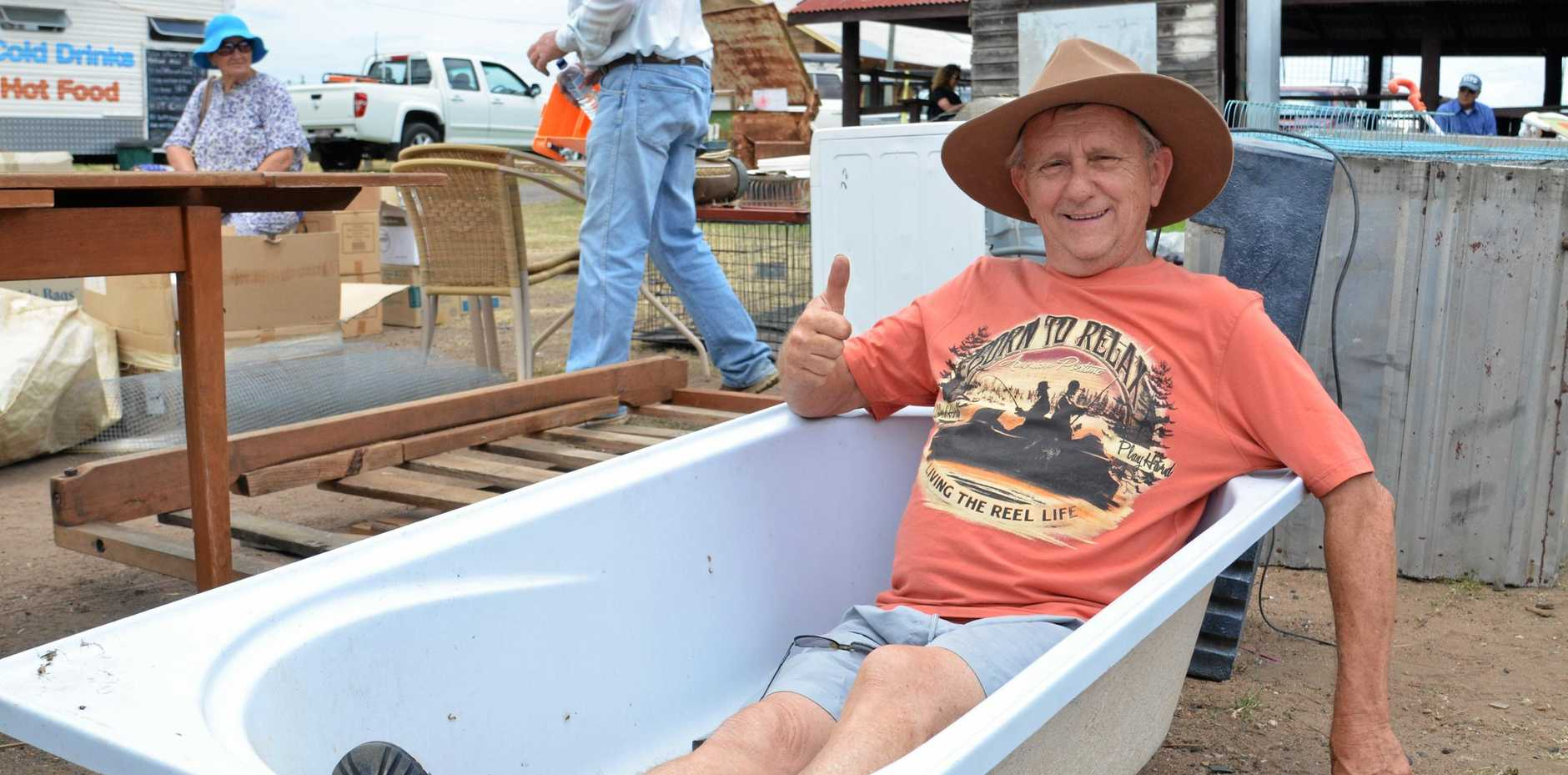 BARGAIN: Neil Hill purchased a bath tub at the Warwick Pig and Calf Sale on November 21. He'll use it to keep his geese clean.