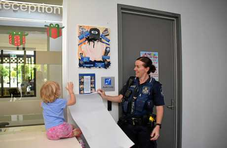 HELPING HANDS: Constable Connor Anderson had the help of her daughter Rose for the unveiling of the stunning portrait.