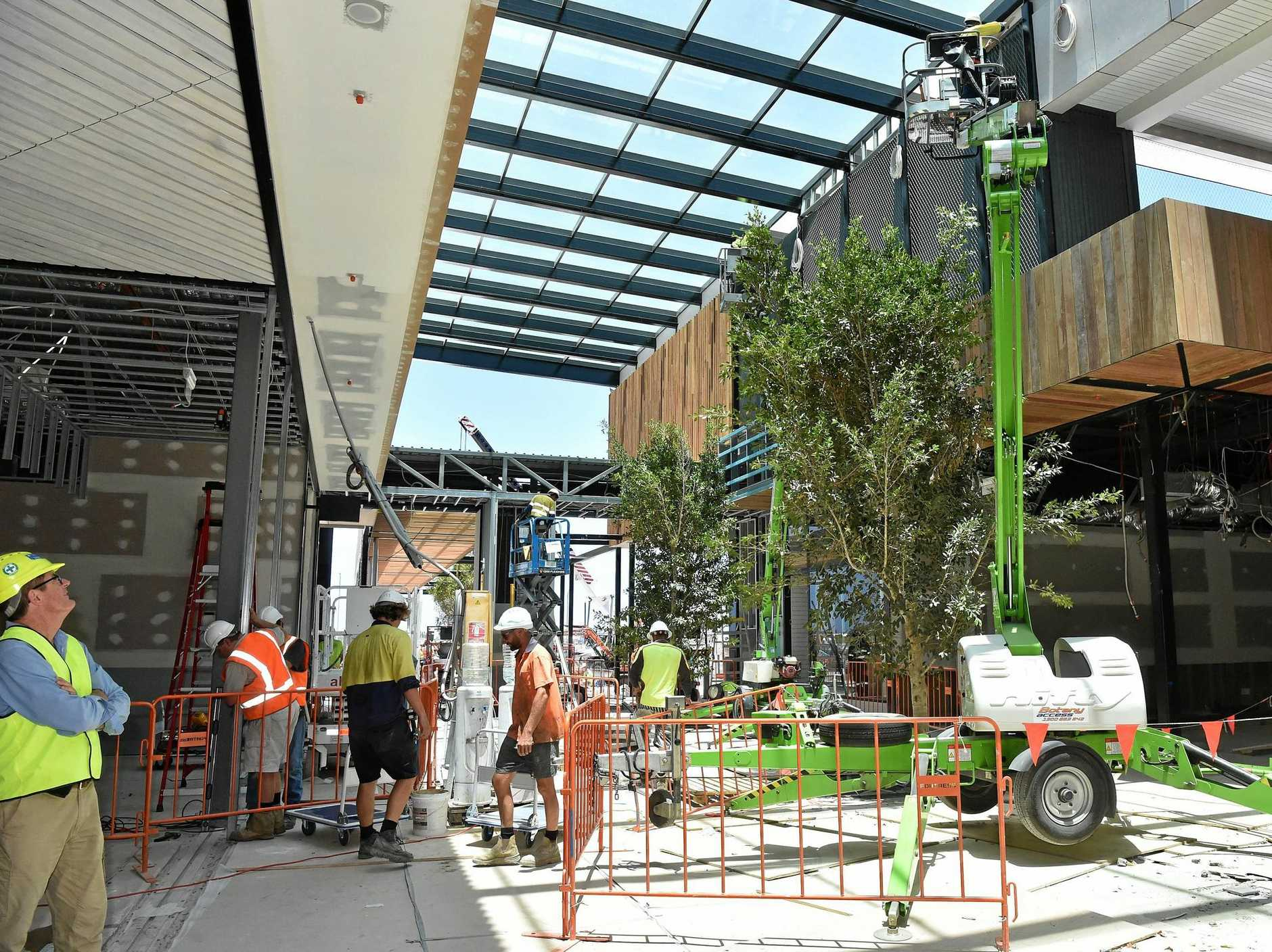 Full steam ahead for the opening of the Stockland Birtinya Shopping Centre. Construction workers put the final pieces together for the grand opening in a couple of weeks.