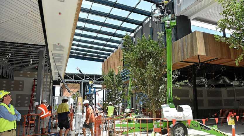 Construction crews work at Stockland Birtinya shopping centre.