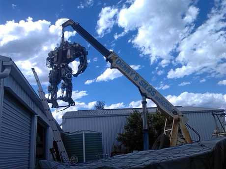 A crane was needed to move Earl from his shed to the front lawn.