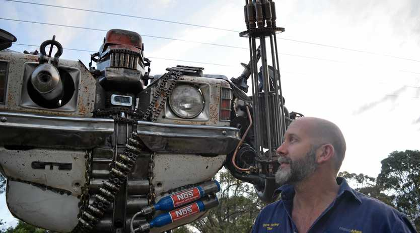 GIANT MATE: Steve Henley from Mount Marshall put in 250 hours of work to create a three-metre tall robot called Earl.