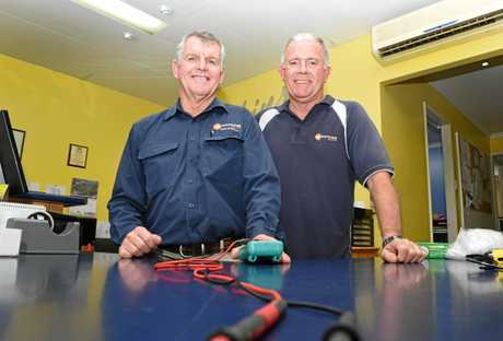 Co-owners Peter Stocks and Peter Robbins from Watkins Electrical with a testing unit.