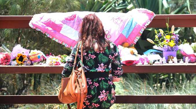 A member of the public pausing in memory of the little girl (AAP image, John Gass)