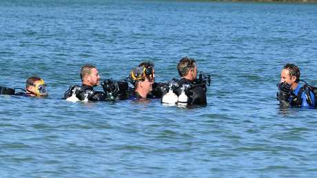 Police divers look for evidence at Jack Evans Boat Harbour. Picture: AAP/John Gass