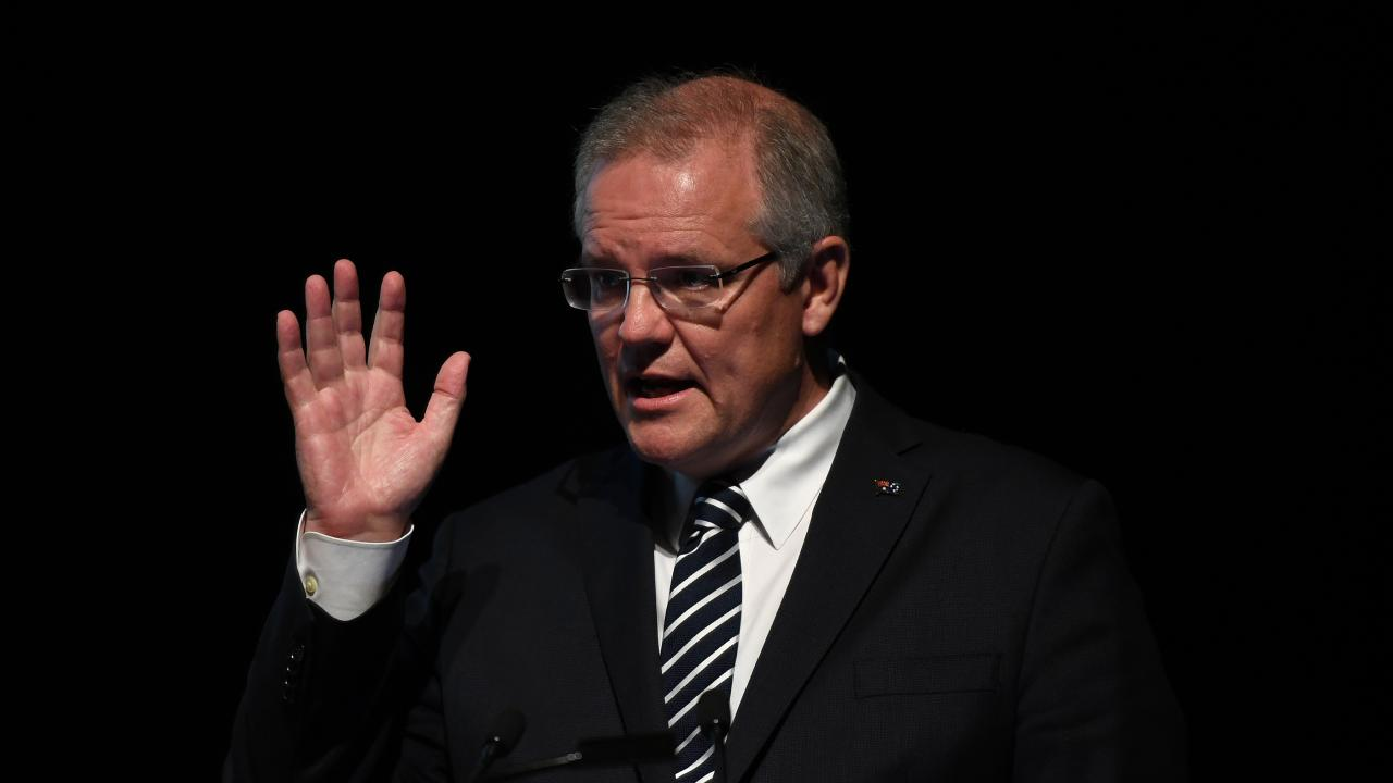 Prime Minister Scott Morrison wants to cut the total number of immigrants. Picture: AAP Image/Joel Carrett